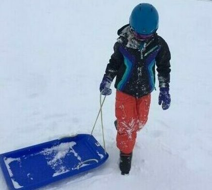 Student with toboggan at Perisher