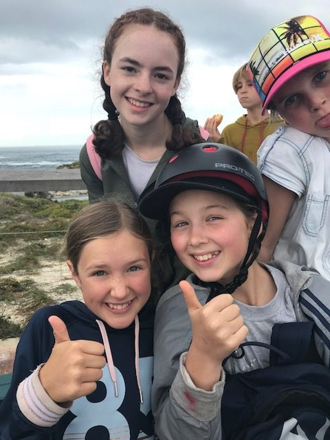 thumbs up by happy students