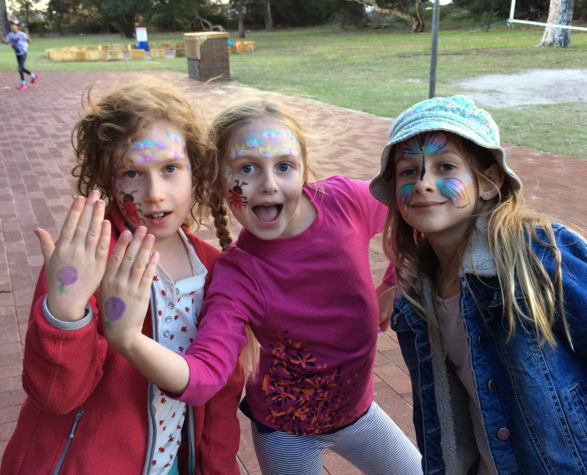 3 girls with facepaint on their faces