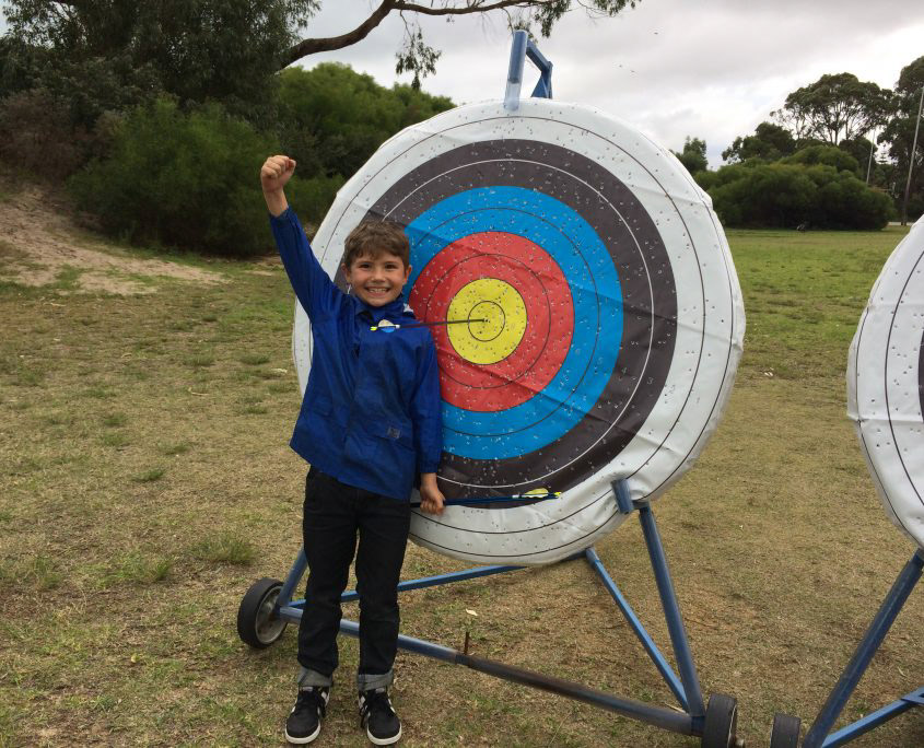 excited student at archery target