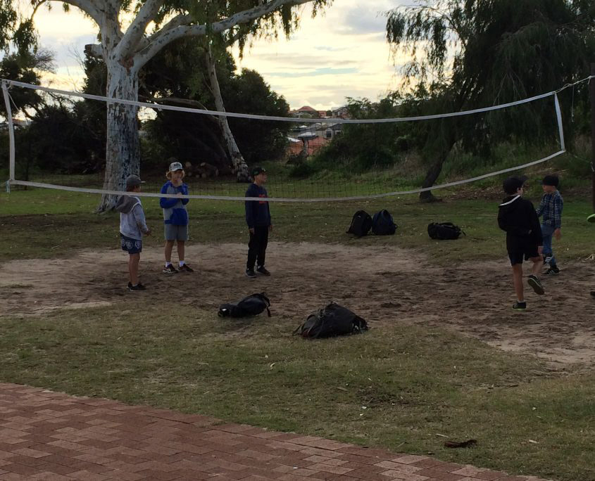 Year 3 and 4 students playing volleyball