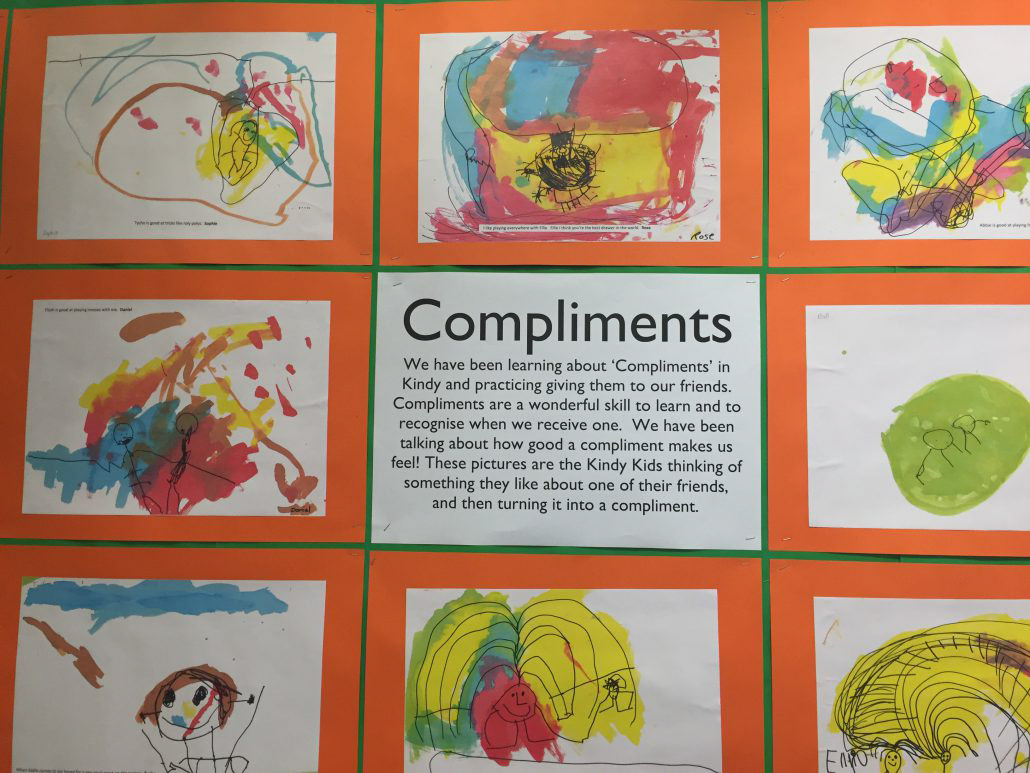 Poster of Compliments and pictures made by kids.