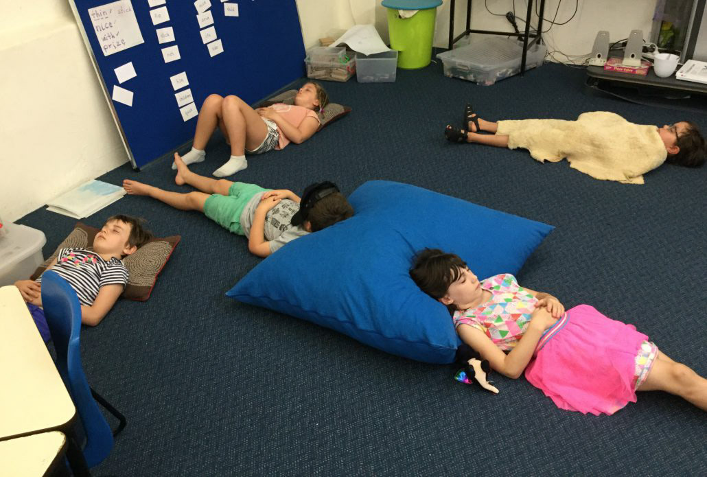 Kids lying on the floor doing mindfulness