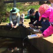 Kids testing water pollutants