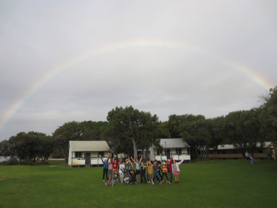 happy students under the rainbow